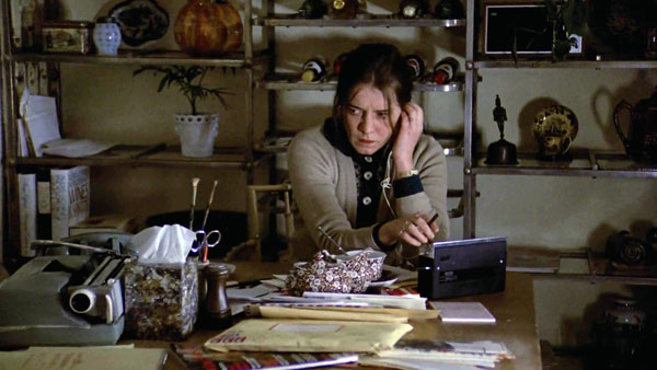 Sharon (Kitty Winn) tunes in to the radio to drown out the exorcism taking place
